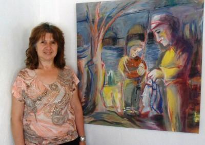 Mirta Córdoba junto a su cuadro